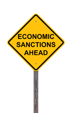 Caution Sign Isolated On White - Economic Sanctions Ahead