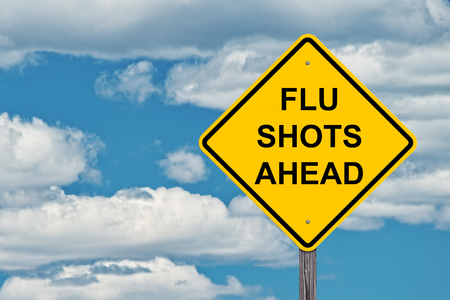 Caution Sign Blue Sky Background - Flu Shots Ahead