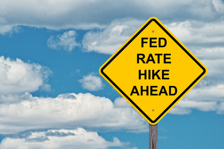 Fed Rate Hike Ahead - Caution Sign Blue Sky Background
