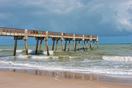 Pier Near Jaycee Park In Vero Beach Florida With Storm Clouds Over The Ocean 스톡 콘텐츠