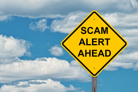 Scam Alert Caution Sign With A Blue Sky Background Stock Photo - 106434732