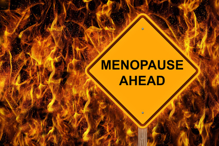 Menopause Ahead Caution Sign With Flaming Background Reklamní fotografie - 106790493