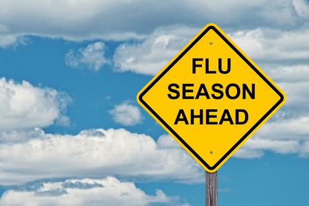 Flu Season Ahead Caution Sign With Blue Sky Background