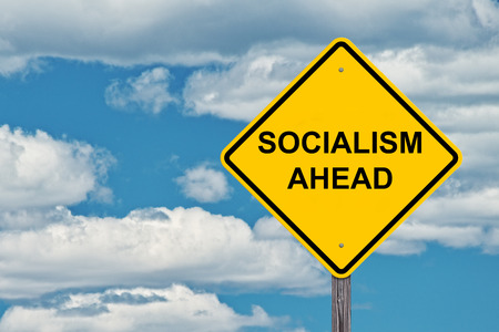 Socialism Ahead Caution Sign With Blue Sky Background Stockfoto