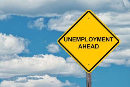 Unemployment Ahead - Caution Sign Blue Sky Background