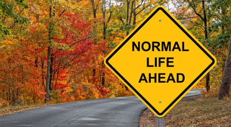 Normal Life Ahead Caution Sign Autumn Background Stock fotó