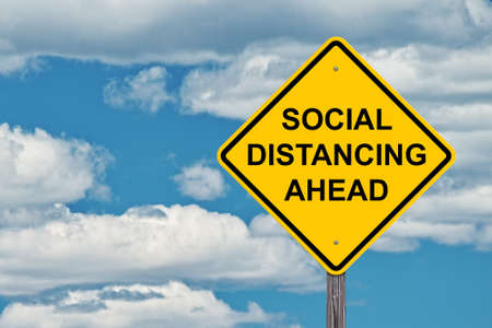 Social Distancing Ahead Caution Sign Blue Sky Background
