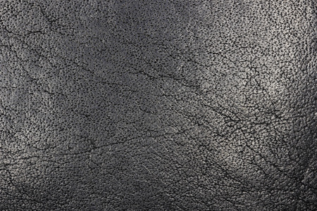 Soft Black Leather Surface Grain Texture macro detail Фото со стока