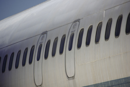 Dirty Passenger Aircraft Fuselage With Windows & Emergency Hatches Close-up