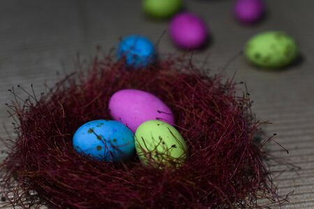 Colorful Candy Speckled Eggs In A Red Nest