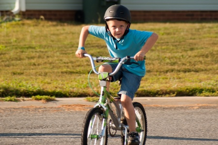 cousin: Boy on bicycle