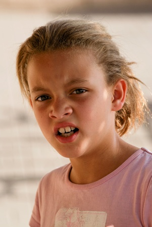 Young girl with disgusted look on her face