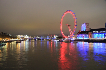 London Eye on the Thames by night