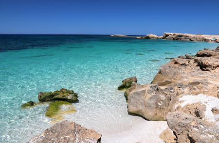 Paradise beach with white sand and crystal water of Sardinia, for holiday in summer