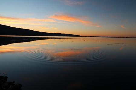Tramonto con vista sulla laguna Maremma Archivio Fotografico - 76746485