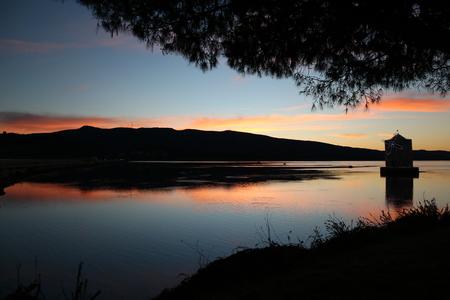 Sunset overlooking Argentario Orbetello lagoon to Tuscany