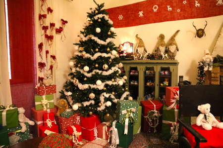 Father Christmas house with tree and gifts