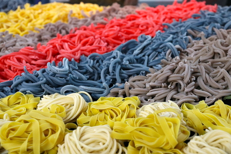 Colored pasta with fancy food