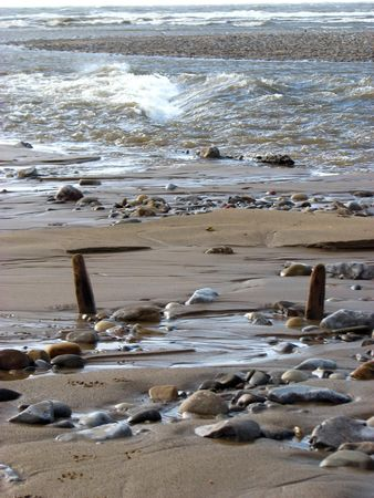 cymru: Where the river meets the sea at Ogmore-By-Sea South Wales Stock Photo