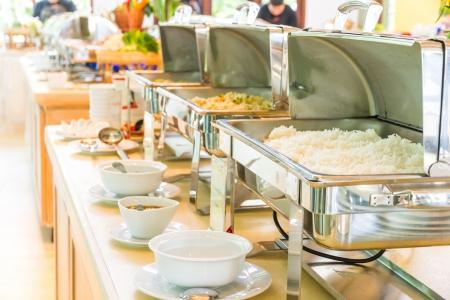 buffet table: Many buffet heated trays ready for service