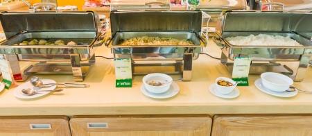 Many buffet heated trays ready for service   photo