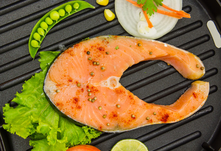 The salmon fish on a pan for design or decorate project. photo