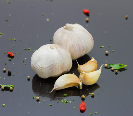 photography background: Garlic on black background for decorate and design project. Stock Photo