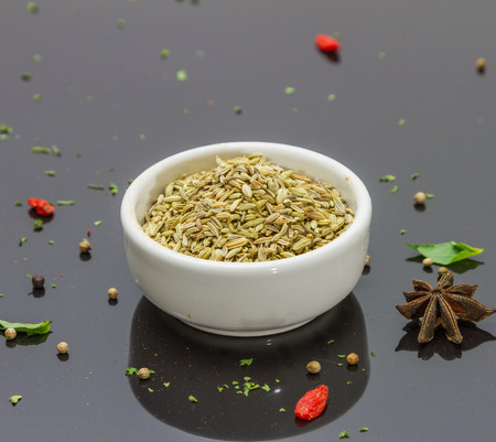 fennel seeds: Fennel seeds on the bowl in black backgroun for decorate and design project.