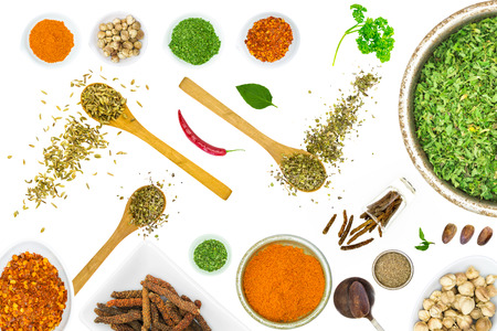 food additives: Spices and herbs in metal bowls. Food and cuisine ingredients. Colorful natural additives for decorate and design project.
