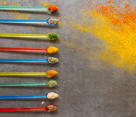 Spices and herbs on the stone background for decorate and design project.