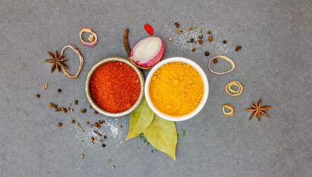 additives: Spices and herbs in metal bowls. Food and cuisine ingredients. Colorful natural additives for decorate and design project.