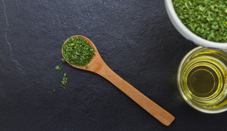 additives: Parsley spices and herbs in metal bowls. Food and cuisine ingredients. Colorful natural additives for decorate and design project.  Image ID: 283928015