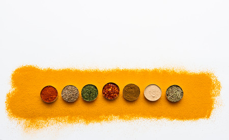 curry bowl: Many spices and herbs selection background for decorate design project. Stock Photo
