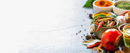 Mixed spices and herbs on background for decorate design.