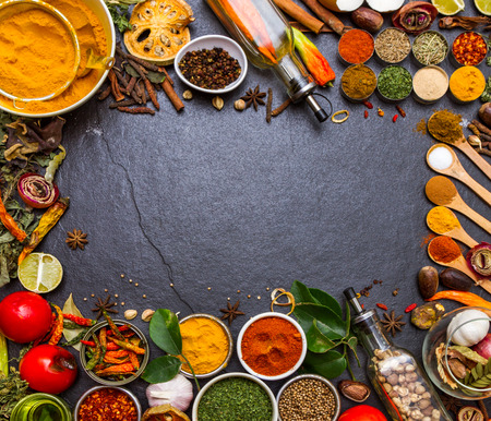 cuisine: Mixed spices and herbs on background for decorate design.