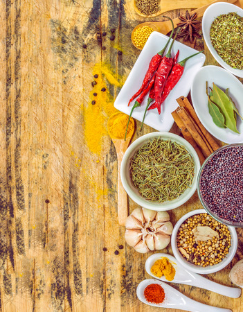 mustard plant: Overhead view depicting cooking with spices in a rustic kitchen