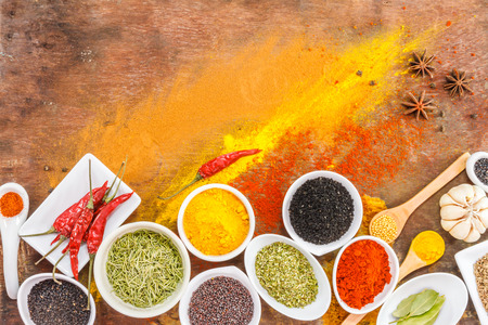 Mix spices on wood texture background for decorate project.