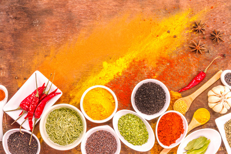 decorate: Mix spices on wood texture background for decorate project.