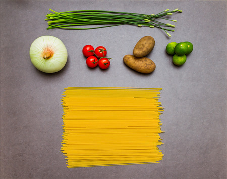 semolina pasta: Raw spaghetti for cooking background and design.