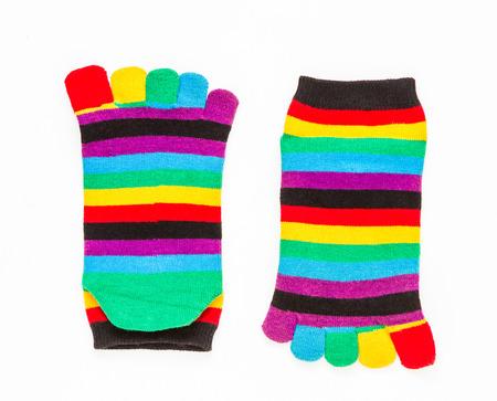 children s feet: Cotton socks on white background for design. Stock Photo