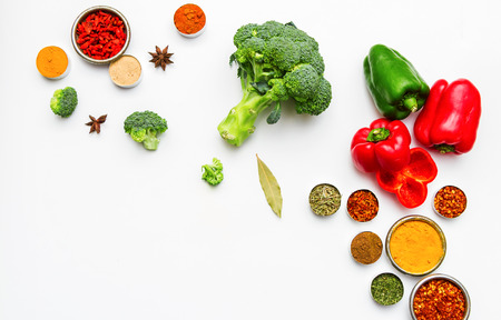 Spices and vegetables for cooking and health on background.