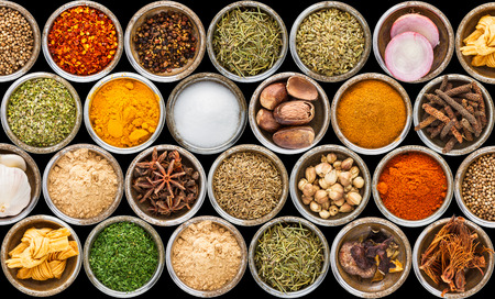spices: Spices and herbs in metal bowls background for decorate and design project.