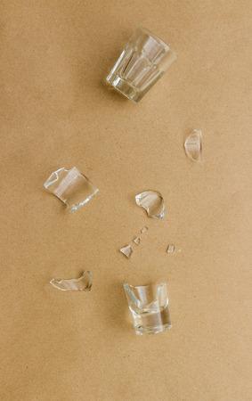 peper: broken glass on brown peper background.