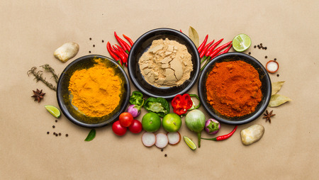 curry bowl: Spices for herb on brown paper background. Stock Photo