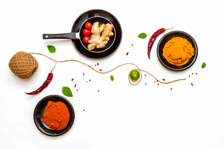 indian cooking: spices for food on background.