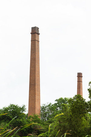 tall chimney: Old aged weathered tall industrial factory chimney on background.