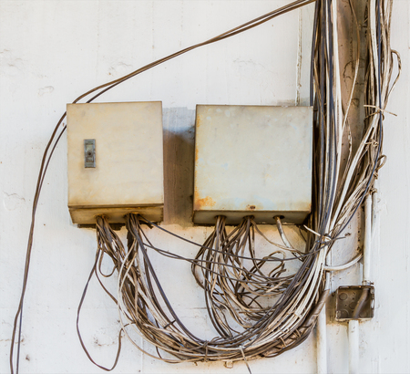 tangling: Breaker box on old dirty wall on background.