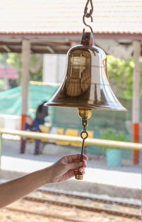 peal: Brass bell at train station on background. Stock Photo