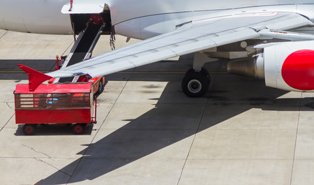 air freight: Loading platform of air freight to the aircraft background.