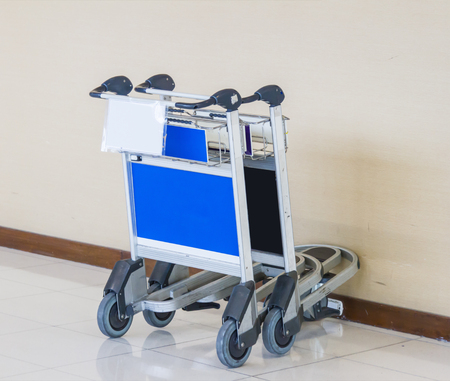 trolly: Airport Luggage Cart on background. Stock Photo